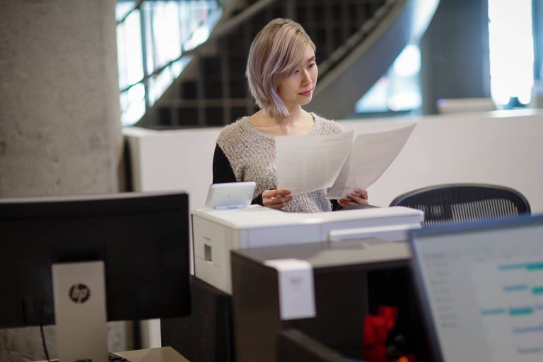 Managed Print Services Vrouw aan printer
